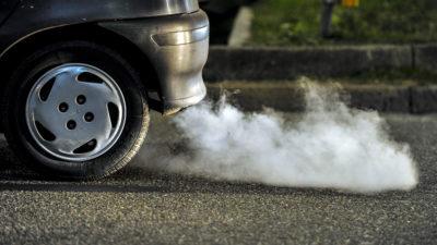 Muffler emitting exhaust