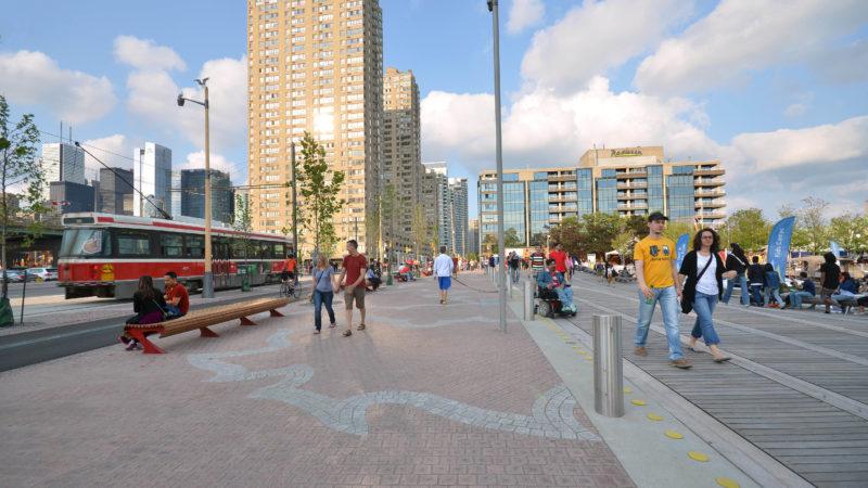 Queens Quey Toronto, with pedestrians and a streetcar