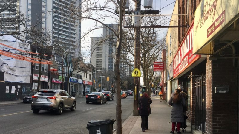 Commercial street in Toronto with crowded sidewalk